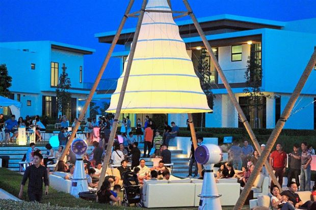 Guests lounging on comfortable sofas under the stars.